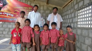 Pastor Manik Rao and Local Leader Srinivas with school children