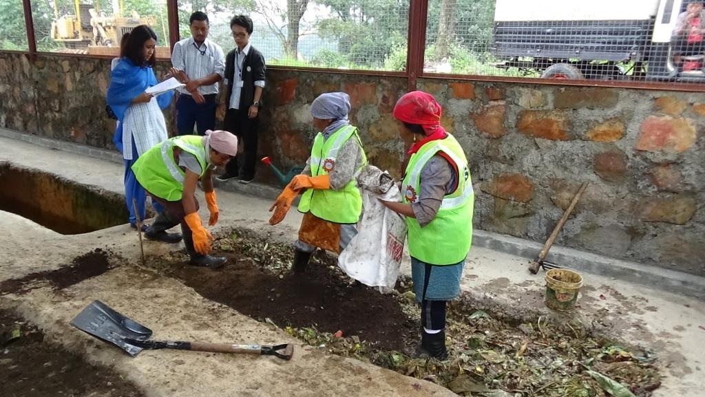 Members engaged in process of composting